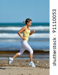 young woman jogging on the... | Shutterstock . vector #91110053