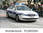 LIMASSOL,CYPRUS-MARCH 6, 2011: Unidentified people and police car during the carnival parade, established in 16th century, influenced by Venetian traditions. - stock photo