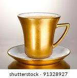 Golden Cup Of Coffee Isolated...