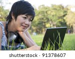 asian lady using computer in a... | Shutterstock . vector #91378607