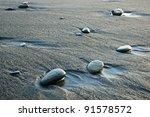Stones Between The Sand Beach