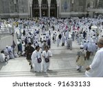MECCA - DEC 5 :Muslim pilgrims in front of Haram Mosque entrance on Dec 5, 2007 in Mecca, Saudi Arabia. Millions of muslims around the world come for hajj during this time. - stock photo