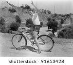 Male Bicyclist Waving