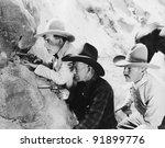 three men with guns - stock photo