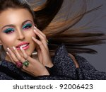 beautiful Italian young oman with fashion bright make-up smiling with hair blowing in the wind. - stock photo