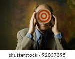 man in suit and tie with target covering face - stock photo