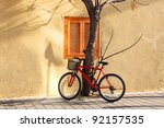 Bicycle Parked Near A Tree On...