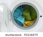 Colorful towels inside washing machine drum - stock photo