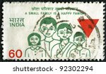 "INDIA - CIRCA 1980: A stamp printed in India shows ""A small family is a happy family"", circa 1980 - stock photo"