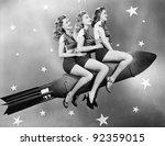 Stock photo three women sitting on a rocket 92359015