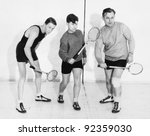 three men playing squash | Shutterstock . vector #92359030