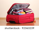 open red suitcase with clothing ... | Shutterstock . vector #92363239