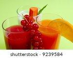 fresh juice mix in three glasses | Shutterstock . vector #9239584