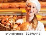 female baker or saleswoman in... | Shutterstock . vector #92396443