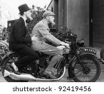Two Men Riding A Motorbike
