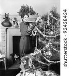 Young Woman Decorating A...
