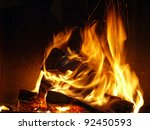 Closeup of firewood burning in fire - stock photo