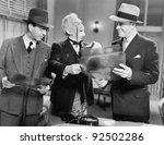 three men looking at x rays   Shutterstock . vector #92502286