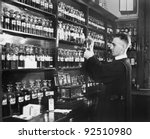 man in a pharmacy mixing... | Shutterstock . vector #92510980