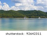 Summer view of a local lake with sailboats and beautiful  forest on the lake shore in Kentucky, USA - stock photo