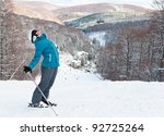 Young Woman With Ski Against...