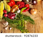 Fresh vegetable on wooden boards. - stock photo