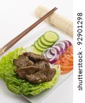 Cambodian (Loc Lac) / Vietnamese (Bo Luc Lac) stir-fried beef salad - Shaking Beef - stock photo