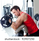 man with weight training equipment on sport gym club - stock photo