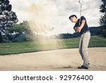 Male Golfer In Blue Shirt And...