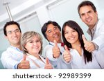 Group Of Doctors With Thumbs U...
