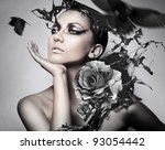 portrait of woman with black splash and crows - stock photo
