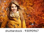 Young Woman With Autumn Leaves...