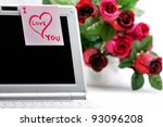 "Sticker ""I Love You"" on a laptop and a bunch of flowers. - stock photo"
