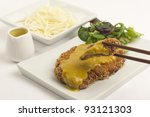 Katsu Kare - Tonkatsu - Japanese breaded deep-fried  pork cutlet served with shredded cabbage and curry sauce. - stock photo