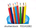 Coloring pencils spread in blue cup - stock photo