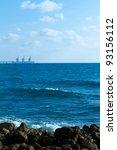 Sea and stones with white background in Caesarea sea port - stock photo
