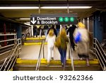 The rush of commuters in a New York City subway going towards Brooklyn - stock photo