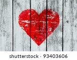 love symbol on old wooden wall - stock photo