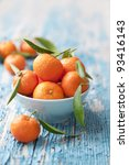 bowl of fresh mandarins, straight from the tree - stock photo
