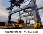 Cargo ship loading containers - stock photo