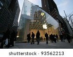 NYC - DEC 30: Pedestrians walk past an official Apple, Inc.  retail center in New York City, New York, on Wednesday,  December 30, 2009. - stock photo