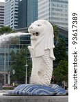 SINGAPORE - JUNE 27: Original Merlion statue fountain in Merlion Park, Singapore, June 27,2009. This fountain is one of most well known icons of Singapore & most important symbol, trademark of country - stock photo