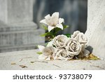 old white fake flower on grave | Shutterstock . vector #93738079