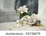 old white fake flower on grave | Shutterstock . vector #93738079