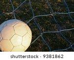 old soccer ball against the net ... | Shutterstock . vector #9381862