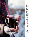 girl holding a glass of hot... | Shutterstock . vector #93829909