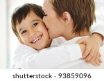 Happy Mother Embracing And...