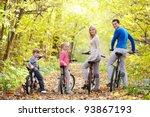 family on bikes in the park in... | Shutterstock . vector #93867193