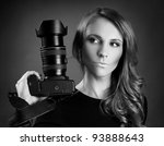 pretty young woman with camera - stock photo