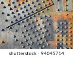 Old rusty rivets on large corroding steel plates of a train and auto Bridge - stock photo